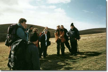 Walkers discussing their route